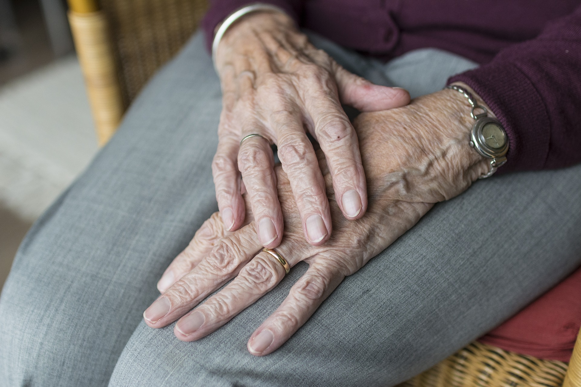 An older lady's hands folded into her lap