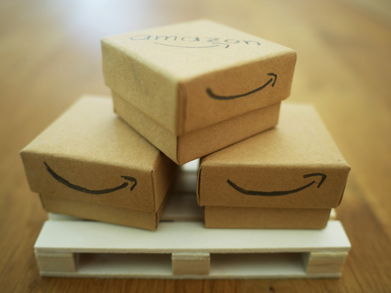 Cardboard boxes stacked up with Amazon smile logo