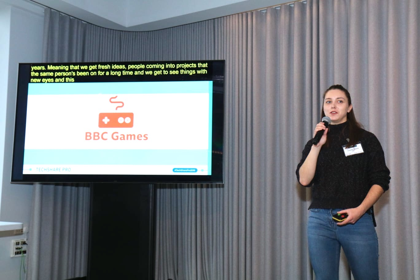 Lauren Moore on stage at TechShare Pro speaking about BBC Games